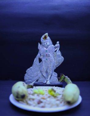 Saraswathi Pooja and Ayudha Pooja Celebrations - Silver idol Murugan with banana stock vector