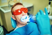 Teeth whitening in dental clinic for pretty patienta