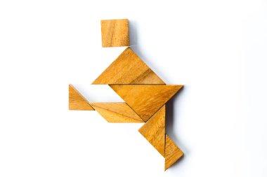 Wood tangram puzzle in man dancing or kicking shape on white background