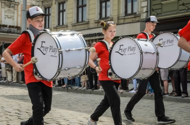 LVIV, UKRAINE - MAY 2018: The musical orchestra performs at an exhibition concert during a parade in the center of the city