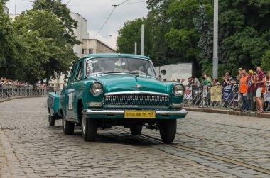LVIV, UKRAINE - JUNE 2018: Soviet old vintage retro car GAZ Volga 21 driving through the streets of the city