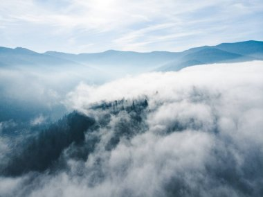 aerial view of clods and fog over mountains hills. magic time. beautiful nature