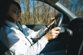 woman in sunglasses driving car