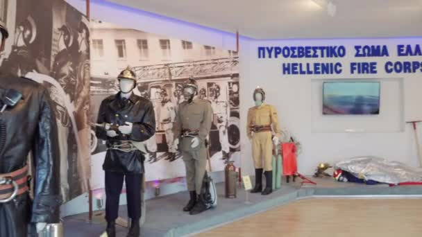 Thessaloniki, Greece - September 08 2019: Greek Fire Service old uniforms on display. Evolution of Hellenic Fire Corps on exhibition firefighter dummies with helmets at 84th Thessaloniki Fair.