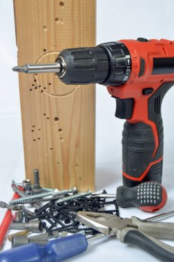 Repair tools ( screwdriver, screws, screwdriver) and wooden Board on white background