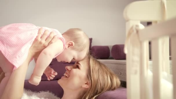 Happy mom with child. Mother enjoy baby laughing