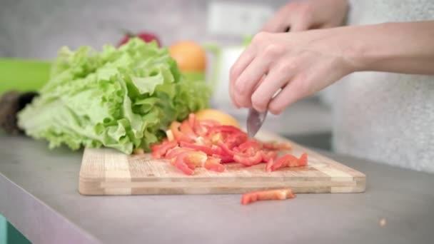 Woman cooking vegetables salad. Cooking healthy food. Woman preparing dinner