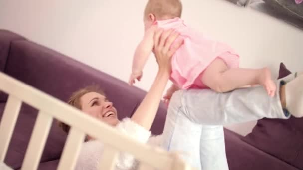 Beautiful mom playing with baby. Carefree family. Cheerful woman happy with baby