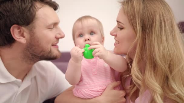 Beautiful family with baby. Sweet family love. Mom and dad kissing child girl