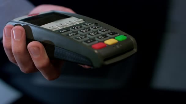 Pos terminal payment. Human hand swipe credit card in payment terminal. Credit card machine for money transaction. Easy shopping service. Card pay