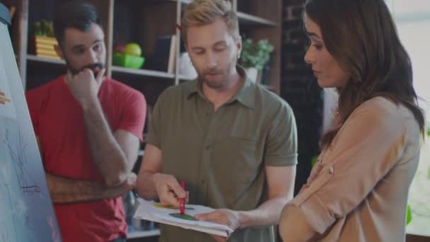 Creative businessman explaining idea to skeptical colleagues. Business people