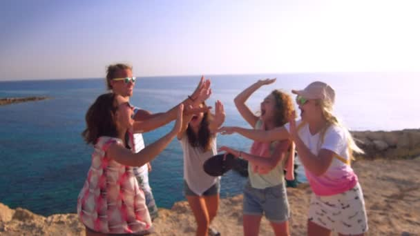 Cheerful young tourist greet each other in slow motion. Happy friendship concept