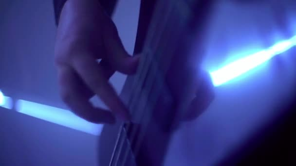 Human hands playing on electric guitar. Rock and roll musical show