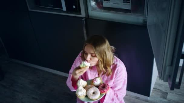 Sweet woman eating cake with appetite. Eating woman enjoy cupcake