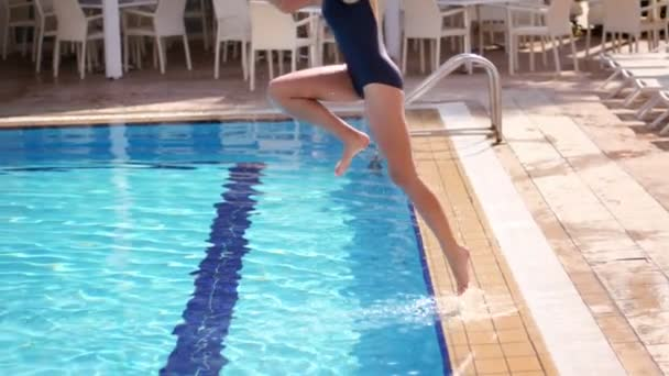 Summer girl jumping in pool. Hot girl have fun at resort pool. Enjoy summer time