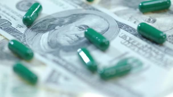 Herbal capsules on dollar cash. Medical finance. Healthcare business