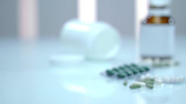 Male hand pour medical pills from bottle. Vitamins and supplements