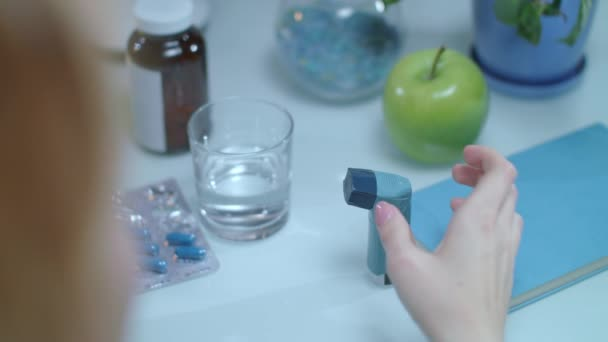 Asthma inhaler on table. Medical equipment on treatment of asthma attack