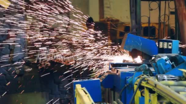 Automatic welding machine working at factory. Bright metal sparks throwing