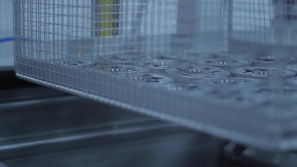 Lattice container with metal billets moving along production line