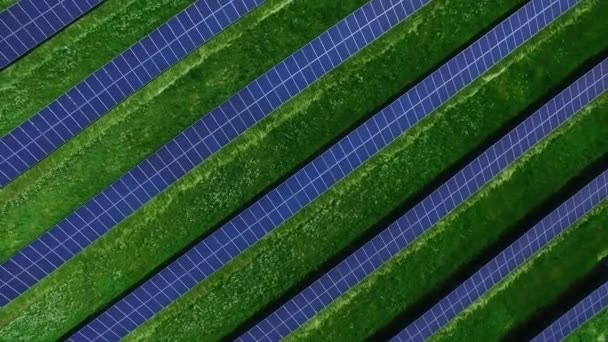 Solar panels on energy farm in countryside landscape. Aerial view straight rows of photovoltaic panels on green field. Modern solar station infrastructure. Green energy innovation industry