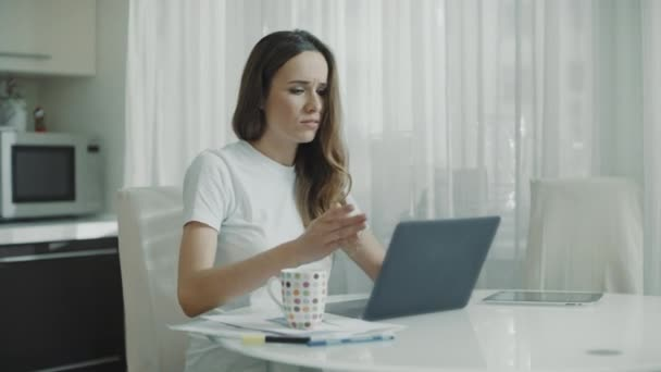 Angry woman have problem with work online on laptop at home