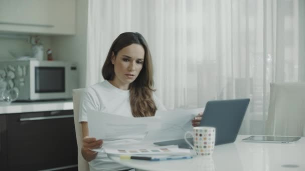 Business woman analysing financial data charts at home workplace