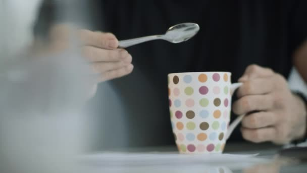 Man hand holding coffee cup. Close up of male hand preparing to drink tea