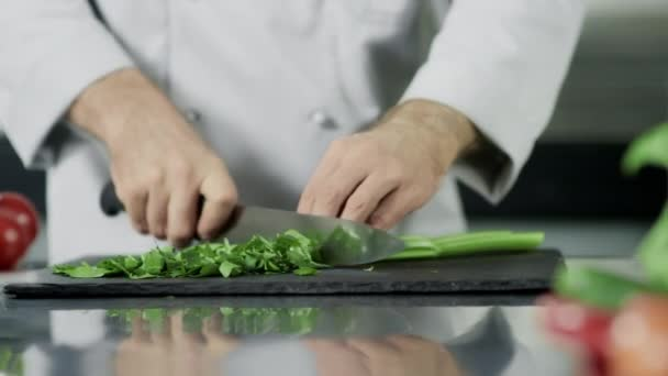 Chef hands cutting celeriac at kitchen. Closeup chef hands cooking greenery.