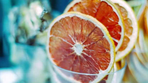 Red grapefruit slices in glass prepared for use in cocktails