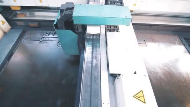 Machine cutting metal in factory. Hi-technology manufacturing