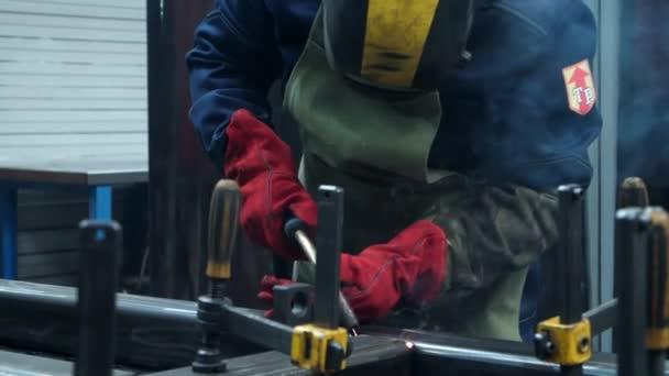 Process of autogenous welding at industrial enterprise. Industrial steel welder