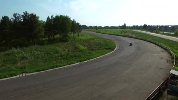 Drone view motorcycle rider driving on racing track. Aerial view moto riding