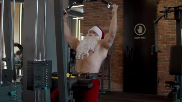 Strong santa claus doing bench press at gym. Sportsman training in sport club