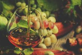 Photo Cognac Pour In Glass, Grapes And Vine, Vintage Wood Background