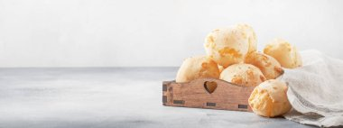 Delicious custard cheese buns on gray kitchen table background, selective focus. Place for text, banner