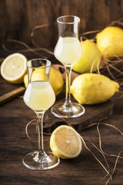 Limoncello, sour sweet Italian lemon liqueur, traditional strong alcoholic drink. Copy space, selective focus