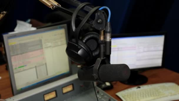 Radio station, professional mixer console, microphone and headphones.