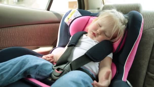 Small Child Sleeping Car Seat Traveling Stock Video