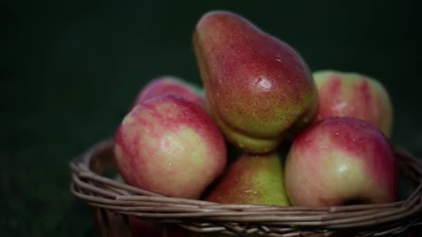Apples and pears in the basket. Fruits, close-up.