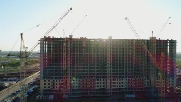 High building cranes building. City building.