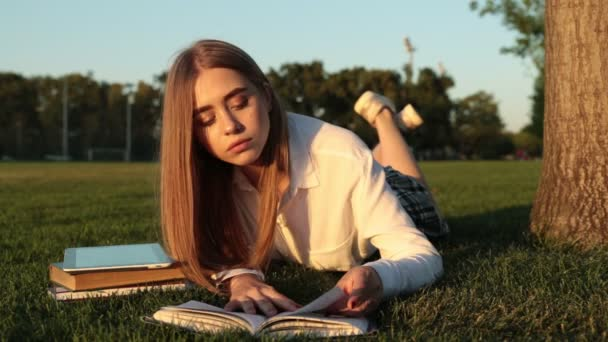 Beautiful female student reading a book.