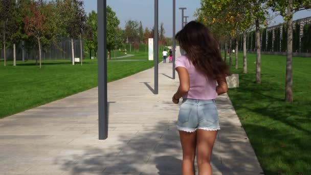 Beautiful woman running in the park. Fitness, slow motion.