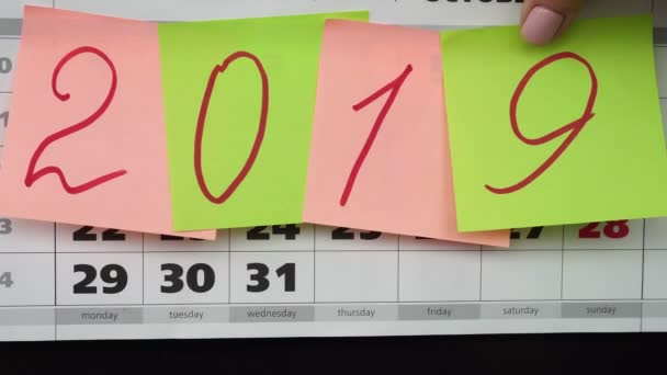 Idea of the New Year 2019. Calendar and colored stickers with numbers 2019.
