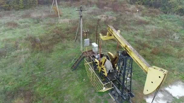 Extraction of oil or gas using a pump rocking. Pumpjack for oil production.
