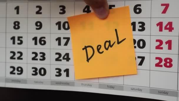 Office calendar, sticker with the inscription deal.