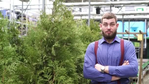 Man businessman farmer in a greenhouse.