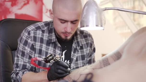 Portrait of a tattoo artist during work.