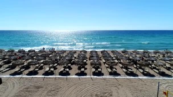 Beautiful sandy beach, seaside resort, clear sea, sunlight.