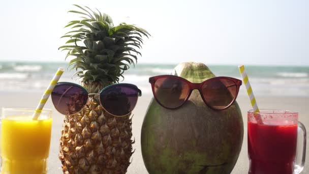 Fruit tourist family pineapple and coconut on a sandy sea beach